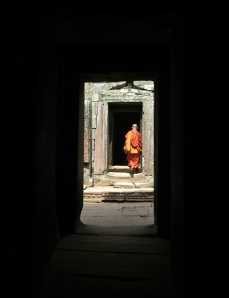 a Buddhist monk exploring the temples of Angkor