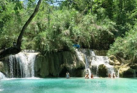 Ian - full flight on the rope swing at Tat Kuang Si Waterfalls