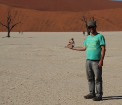 Sossusvlei Clay Pan - in the palm of his hand!