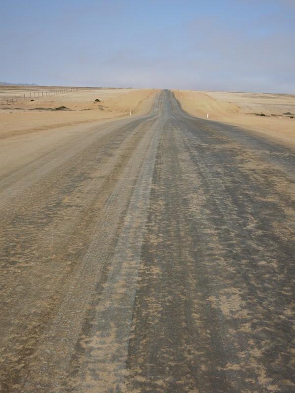 On the road in Namibia Skeleton Coast, toward Swukmpund.