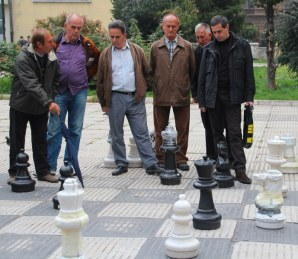 The older generation loudly and excitedly playing an open game of chess