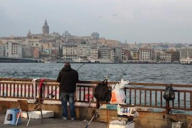 A fisherman near the Galata Bridge