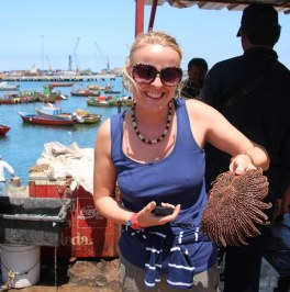 Danielle not so happy just to be handed this sea urchin type thing...