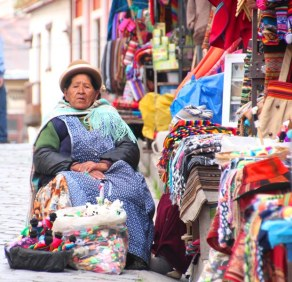 Indigenous woman selling crafts at the market